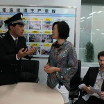 Janet Yang On Set with officer