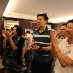 Janet Yang with Daniel Hsia and Crew Clapping